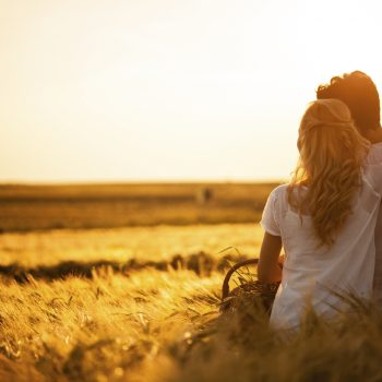 Loving couple in wheat field.
